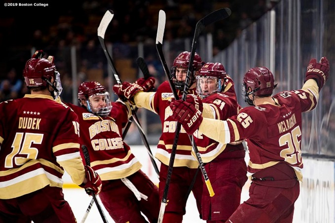 March 22, 2019, Boston, MA: Christopher Grando #21 of Boston College reacts with teammates after scoring a goal during the third period of the 2019 Hockey East semi-final game against University of Massachusetts at TD Garden in Boston, Massachusetts Friday, March 22, 2019. (Photo by Billie Weiss/Boston College)