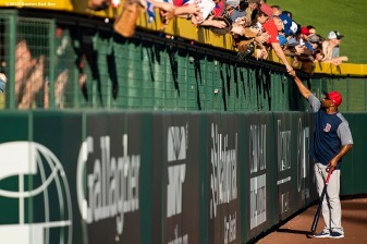MESA, AZ - MARCH 25: First base coach Tom Goodwin of the Boston Red Sox high fives a fan before a spring training game against the Chicago Cubs on March 25, 2019 at Sloan Park in Mesa, Arizona. (Photo by Billie Weiss/Boston Red Sox/Getty Images) *** Local Caption *** Tom Goodwin