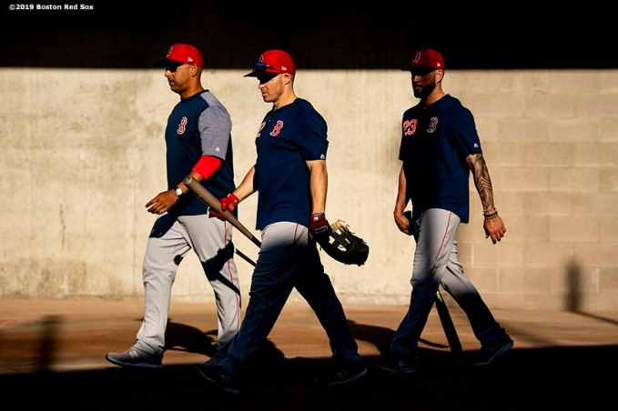 MESA, AZ - MARCH 25: Manager Alex Cora, Brock Holt #12, and Blake Swihart #23 of the Boston Red Sox walk toward the locker room before a spring training game against the Chicago Cubs on March 25, 2019 at Sloan Park in Mesa, Arizona. (Photo by Billie Weiss/Boston Red Sox/Getty Images) *** Local Caption *** Alex Cora; Brock Holt; Blake Swihart