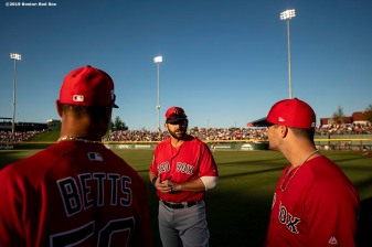 MESA, AZ - MARCH 25: Andrew Benintendi #16 talks with Mitch Moreland #18 and Mookie Betts #50 of the Boston Red Sox before a spring training game against the Chicago Cubs on March 25, 2019 at Sloan Park in Mesa, Arizona. (Photo by Billie Weiss/Boston Red Sox/Getty Images) *** Local Caption *** Andrew Benintendi; Mitch Moreland; Mookie Betts
