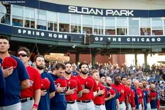 MESA, AZ - MARCH 25: Members of the Boston Red Sox line up as the National Anthem is played before a spring training game against the Chicago Cubs on March 25, 2019 at Sloan Park in Mesa, Arizona. (Photo by Billie Weiss/Boston Red Sox/Getty Images) *** Local Caption ***
