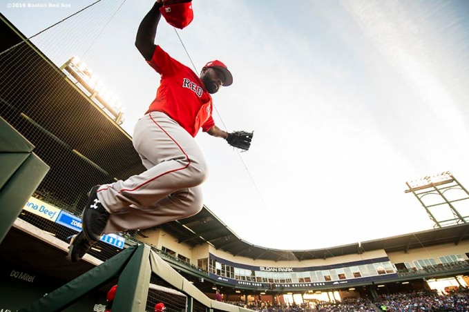 MESA, AZ - MARCH 25: Jackie Bradley Jr. #19 of the Boston Red Sox leaps as he exits the dugout during the first inning of a spring training game against the Chicago Cubs on March 25, 2019 at Sloan Park in Mesa, Arizona. (Photo by Billie Weiss/Boston Red Sox/Getty Images) *** Local Caption *** Jackie Bradley Jr.