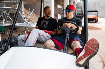 MESA, AZ - MARCH 26: Mookie Betts #50 and Brock Holt #12 of the Boston Red Sox react as they sit in a golf cart before a spring training game against the Chicago Cubs on March 26, 2019 at Sloan Park in Mesa, Arizona. (Photo by Billie Weiss/Boston Red Sox/Getty Images) *** Local Caption *** Mookie Betts; Brock Holt