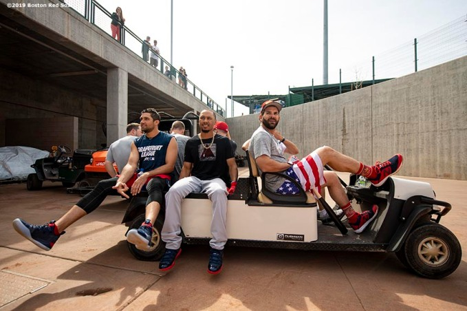 MESA, AZ - MARCH 26: Nathan Eovaldi #17, Mookie Betts #50, and Mitch Moreland #18 of the Boston Red Sox ride in a golf cart before a spring training game against the Chicago Cubs on March 26, 2019 at Sloan Park in Mesa, Arizona. (Photo by Billie Weiss/Boston Red Sox/Getty Images) *** Local Caption *** Nathan Eovaldi; Mookie Betts; Mitch Moreland