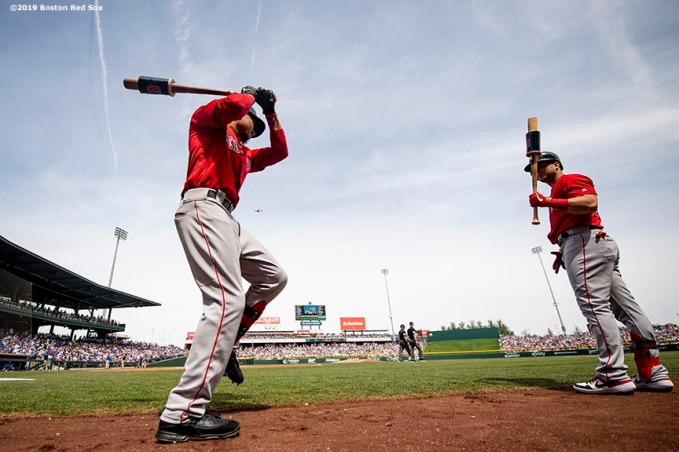 MESA, AZ - MARCH 26: Mookie Betts #50 and Andrew Benintendi #16 of the Boston Red Sox warm up on deck before a spring training game against the Chicago Cubs on March 26, 2019 at Sloan Park in Mesa, Arizona. (Photo by Billie Weiss/Boston Red Sox/Getty Images) *** Local Caption *** Andrew Benintendi; Mookie Betts