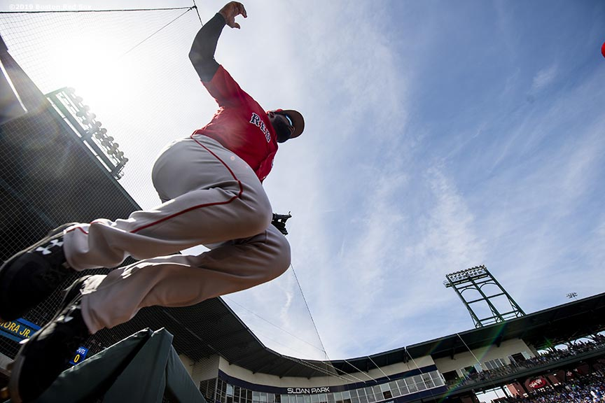 MESA, AZ - MARCH 26: Jackie Bradley Jr. #19 of the Boston Red Sox leaps as he runs onto the field during the first inning of a spring training game against the Chicago Cubs on March 26, 2019 at Sloan Park in Mesa, Arizona. (Photo by Billie Weiss/Boston Red Sox/Getty Images) *** Local Caption *** Jackie Bradley Jr.
