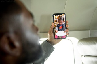 SEATTLE, WA - MARCH 27: Jackie Bradley Jr. #19 of the Boston Red Sox face times his daughter Emerson before a charter flight over Mount Rainier in Seattle, Washington on March 27, 2019. (Photo by Billie Weiss/Boston Red Sox/Getty Images) *** Local Caption *** Jackie Bradley Jr.
