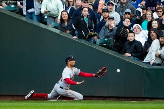 SEATTLE, WA - MARCH 28: Mookie Betts #50 of the Boston Red Sox attempts to catch a foul ball during the sixth inning of the 2019 Opening day game against the Seattle Mariners at T-Mobile Park on March 28, 2019 in Seattle, Washington. (Photo by Billie Weiss/Boston Red Sox/Getty Images) *** Local Caption *** Mookie Betts