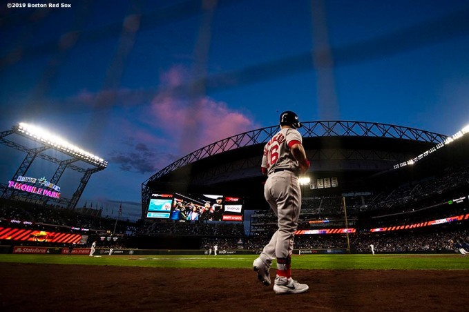 SEATTLE, WA - MARCH 28: Andrew Benintendi #16 of the Boston Red Sox warms up on deck during the ninth inning of the 2019 Opening day game against the Seattle Mariners at T-Mobile Park on March 28, 2019 in Seattle, Washington. (Photo by Billie Weiss/Boston Red Sox/Getty Images) *** Local Caption *** Andrew Benintendi