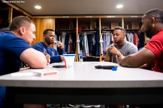 SEATTLE, WA - MARCH 28: Christian Vazquez #7, Rafael Devers #11, Xander Bogaerts #2, and Eduardo Nunez #36 of the Boston Red Sox play cards before the 2019 Opening day game against the Seattle Mariners at T-Mobile Park in Seattle, Washington on March 28, 2019. (Photo by Billie Weiss/Boston Red Sox/Getty Images) *** Local Caption *** Christian Vazquez; Rafael Devers; Xander Bogaerts; Eduardo Nunez