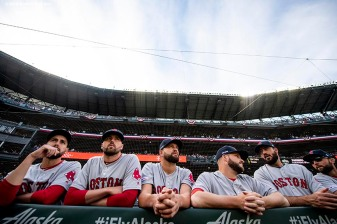 SEATTLE, WA - MARCH 28: Matt Barnes #32, Heath Hembree #37, Brian Johnson #61, Ryan Brasier #70, Brandon Workman #44, and Sam Travis #59 of the Boston Red Sox look on before the 2019 Opening day game against the Seattle Mariners at T-Mobile Park in Seattle, Washington on March 28, 2019. (Photo by Billie Weiss/Boston Red Sox/Getty Images) *** Local Caption *** Matt Barnes; Heath Hembree; Brian Johnson; Ryan Brasier; Brandon Workman; Sam Travis