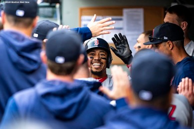 SEATTLE, WA - MARCH 28: Mookie Betts #50 of the Boston Red Sox high fives teammates after scoring during the first inning of the 2019 Opening day game against the Seattle Mariners at T-Mobile Park in Seattle, Washington on March 28, 2019. (Photo by Billie Weiss/Boston Red Sox/Getty Images) *** Local Caption *** Mookie Betts