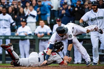 SEATTLE, WA - MARCH 28: Mitch Haniger #17 of the Seattle Mariners is tagged out by Christian Vazquez #7 of the Boston Red Sox during the second inning of the 2019 Opening day game at T-Mobile Park on March 28, 2019 in Seattle, Washington. (Photo by Billie Weiss/Boston Red Sox/Getty Images) *** Local Caption *** Mitch Haniger; Christian Vazquez