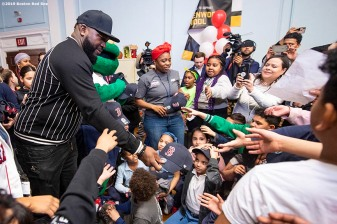 April 4, 2019 , Boston, MA: Former Boston Red Sox designated hitter David Ortiz gives away hats to students during a visit to the Sarah Greenwood School in Dorchester, Massachusetts Thursday, April 4, 2019. (Photo by Billie Weiss/Boston Red Sox)