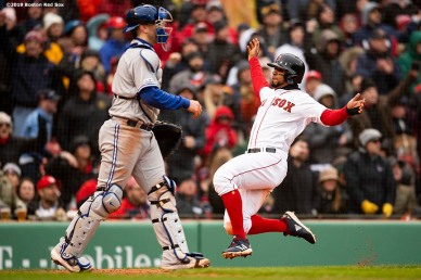 BOSTON, MA - APRIL 9: Xander Bogaerts #2 of the Boston Red Sox slides as he scores during the sixth inning of the Opening Day game against the Toronto Blue Jays on April 9, 2019 at Fenway Park in Boston, Massachusetts. (Photo by Billie Weiss/Boston Red Sox/Getty Images) *** Local Caption *** Xander Bogaerts
