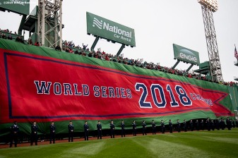 BOSTON, MA - APRIL 9: The Boston Red Sox 2018 World Series banner is dropped over the Green Monster during a 2018 World Series championship ring ceremony before the Opening Day game against the Toronto Blue Jays on April 9, 2019 at Fenway Park in Boston, Massachusetts. (Photo by Billie Weiss/Boston Red Sox/Getty Images) *** Local Caption ***