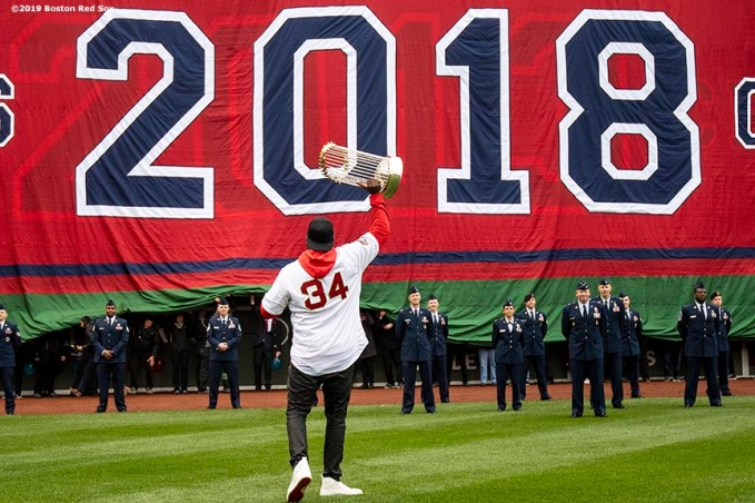 BOSTON, MA - APRIL 9: Former designated hitter David Ortiz of the Boston Red Sox is introduced with the World Series trophy during a 2018 World Series championship ring ceremony before the Opening Day game against the Toronto Blue Jays on April 9, 2019 at Fenway Park in Boston, Massachusetts. (Photo by Billie Weiss/Boston Red Sox/Getty Images) *** Local Caption *** David Ortiz