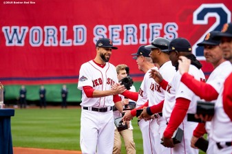 BOSTON, MA - APRIL 9: David Price #24 of the Boston Red Sox high fives teammates during a 2018 World Series championship ring ceremony before the Opening Day game against the Toronto Blue Jays on April 9, 2019 at Fenway Park in Boston, Massachusetts. (Photo by Billie Weiss/Boston Red Sox/Getty Images) *** Local Caption *** David Price
