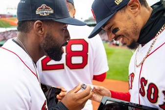 BOSTON, MA - APRIL 9: Jackie Bradley Jr. and Mookie Betts #50 of the Boston Red Sox look at their rings during a 2018 World Series championship ring ceremony before the Opening Day game against the Toronto Blue Jays on April 9, 2019 at Fenway Park in Boston, Massachusetts. (Photo by Billie Weiss/Boston Red Sox/Getty Images) *** Local Caption *** Jackie Bradley Jr.; Mookie Betts