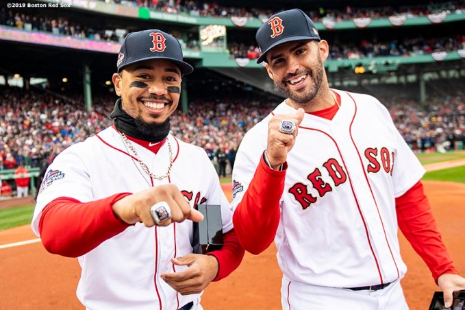 BOSTON, MA - APRIL 9: Mookie Betts #50 and J.D. Martinez #28 of the Boston Red Sox pose with their rings during a 2018 World Series championship ring ceremony before the Opening Day game against the Toronto Blue Jays on April 9, 2019 at Fenway Park in Boston, Massachusetts. (Photo by Billie Weiss/Boston Red Sox/Getty Images) *** Local Caption *** Mookie Betts; J.D. Martinez