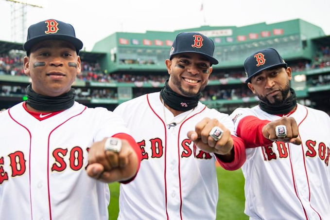 BOSTON, MA - APRIL 9: Rafael Devers #11, Xander Bogaerts #2, and Eduardo Nunez #36 of the Boston Red Sox pose with their rings during a 2018 World Series championship ring ceremony before the Opening Day game against the Toronto Blue Jays on April 9, 2019 at Fenway Park in Boston, Massachusetts. (Photo by Billie Weiss/Boston Red Sox/Getty Images) *** Local Caption *** Rafael Devers; Xander Bogaerts; Eduardo Nunez