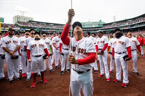 BOSTON, MA - APRIL 9: Manager Alex Cora of the Boston Red Sox raises the 2018 World Series flag surrounded by teammates during a 2018 World Series championship ring ceremony before the Opening Day game against the Toronto Blue Jays on April 9, 2019 at Fenway Park in Boston, Massachusetts. (Photo by Billie Weiss/Boston Red Sox/Getty Images) *** Local Caption *** Alex Cora