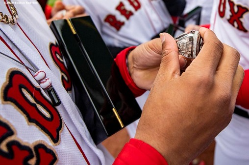BOSTON, MA - APRIL 9: Mookie Betts #50 of the Boston Red Sox looks at his ring during a 2018 World Series championship ring ceremony before the Opening Day game against the Toronto Blue Jays on April 9, 2019 at Fenway Park in Boston, Massachusetts. (Photo by Billie Weiss/Boston Red Sox/Getty Images) *** Local Caption *** Mookie Betts