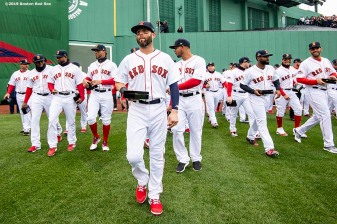 BOSTON, MA - APRIL 9: Dustin Pedroia #15 of the Boston Red Sox walks with his World Series ring during a 2018 World Series championship ring ceremony before the Opening Day game against the Toronto Blue Jays on April 9, 2019 at Fenway Park in Boston, Massachusetts. (Photo by Billie Weiss/Boston Red Sox/Getty Images) *** Local Caption *** Dustin Pedroia