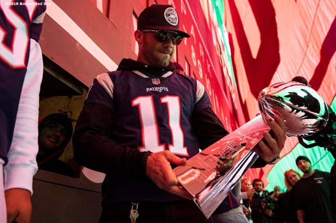 BOSTON, MA - APRIL 9: Julian Edelman #11 of the New England Patriots looks on behind the Green Monster with the Vince Lombardi trophy during the Boston Red Sox 2018 World Series championship ring ceremony before the Opening Day game against the Toronto Blue Jays on April 9, 2019 at Fenway Park in Boston, Massachusetts. (Photo by Billie Weiss/Boston Red Sox/Getty Images) *** Local Caption *** Julian Edelman