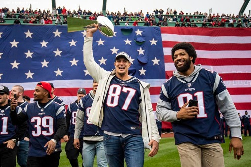 BOSTON, MA - APRIL 9: Rob Gronkowski #87 of the New England Patriots is introduced introduced with the Vince Lombardi trophy during the Boston Red Sox 2018 World Series championship ring ceremony before the Opening Day game against the Toronto Blue Jays on April 9, 2019 at Fenway Park in Boston, Massachusetts. (Photo by Billie Weiss/Boston Red Sox/Getty Images) *** Local Caption *** Rob Gronkowski