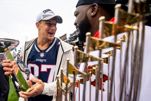 BOSTON, MA - APRIL 9: David Ortiz #34 of the Boston Red Sox reacts with Rob Gronkowski #87 of the New England Patriots as they hold the Vince Lombardi trophy and the World Series trophy during a 2018 World Series championship ring ceremony before the Opening Day game against the Toronto Blue Jays on April 9, 2019 at Fenway Park in Boston, Massachusetts. (Photo by Billie Weiss/Boston Red Sox/Getty Images) *** Local Caption *** David Ortiz; Rob Gronkowski