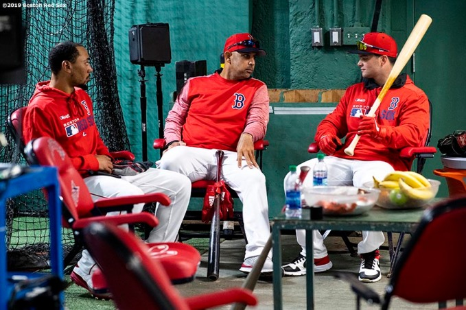 BOSTON, MA - APRIL 11: Mookie Betts #50, manager Alex Cora, and Andrew Benintendi #16 of the Boston Red Sox talk in the batting cage before a game against the Toronto Blue Jays on April 11, 2019 at Fenway Park in Boston, Massachusetts. (Photo by Billie Weiss/Boston Red Sox/Getty Images) *** Local Caption *** Mookie Betts; Alex Cora; Andrew Benintendi