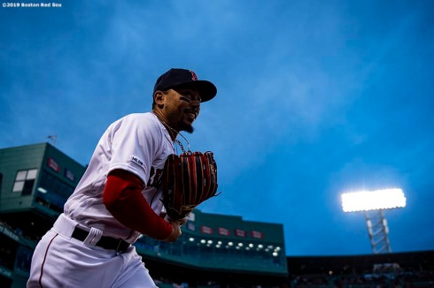 BOSTON, MA - APRIL 11: Mookie Betts #50 of the Boston Red Sox runs onto the field before a game against the Toronto Blue Jays on April 11, 2019 at Fenway Park in Boston, Massachusetts. (Photo by Billie Weiss/Boston Red Sox/Getty Images) *** Local Caption *** Mookie Betts