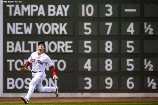 BOSTON, MA - APRIL 11: Andrew Benintendi #16 of the Boston Red Sox attempts to catch a fly ball during the first inning of a game against the Toronto Blue Jays on April 11, 2019 at Fenway Park in Boston, Massachusetts. (Photo by Billie Weiss/Boston Red Sox/Getty Images) *** Local Caption *** Andrew Benitnedni