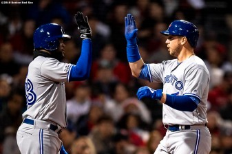 BOSTON, MA - APRIL 11: Justin Smoak #14 of the Toronto Blue Jays high fives Socrates Brito #38 after hitting a three run home run during the third inning of a game against the Boston Red Sox on April 11, 2019 at Fenway Park in Boston, Massachusetts. (Photo by Billie Weiss/Boston Red Sox/Getty Images) *** Local Caption *** Justin Smoak; Socrates Brito