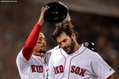 BOSTON, MA - APRIL 11: Mitch Moreland #18 of the Boston Red Sox has his helmet removed by Mookie Betts #50 after hitting a game tying solo home run during the seventh inning of a game against the Toronto Blue Jays on April 11, 2019 at Fenway Park in Boston, Massachusetts. (Photo by Billie Weiss/Boston Red Sox/Getty Images) *** Local Caption *** Mitch Moreland; Mookie Betts