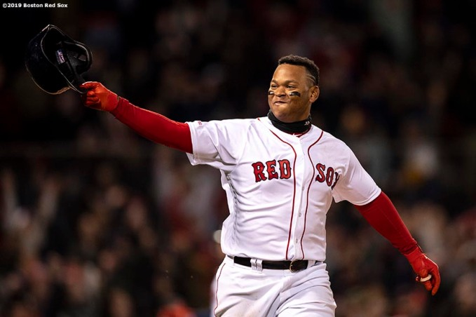 BOSTON, MA - APRIL 11: Rafael Devers #11 of the Boston Red Sox reacts after hitting a game winning walk-off RBI single during the ninth inning of a game against the Toronto Blue Jays on April 11, 2019 at Fenway Park in Boston, Massachusetts. (Photo by Billie Weiss/Boston Red Sox/Getty Images) *** Local Caption *** Rafael Devers
