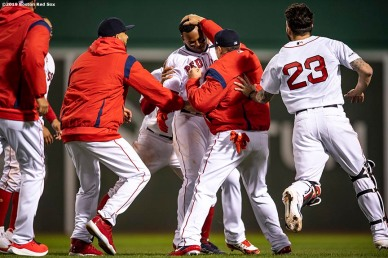 BOSTON, MA - APRIL 11: Rafael Devers #11 of the Boston Red Sox is mobbed by teammates after hitting a game winning walk-off RBI single during the ninth inning of a game against the Toronto Blue Jays on April 11, 2019 at Fenway Park in Boston, Massachusetts. (Photo by Billie Weiss/Boston Red Sox/Getty Images) *** Local Caption *** Rafael Devers