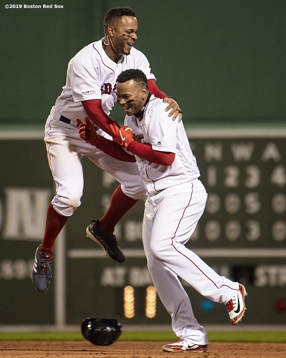BOSTON, MA - APRIL 11: Rafael Devers #11 of the Boston Red Sox reacts with Xander Bogaerts #2 after hitting a game winning walk-off RBI single during the ninth inning of a game against the Toronto Blue Jays on April 11, 2019 at Fenway Park in Boston, Massachusetts. (Photo by Billie Weiss/Boston Red Sox/Getty Images) *** Local Caption *** Rafael Devers; Xander Bogaerts