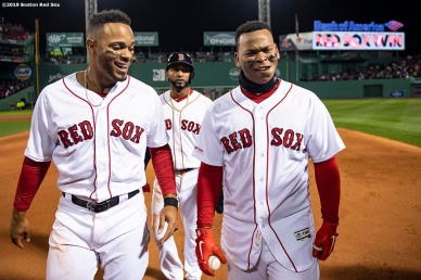 BOSTON, MA - APRIL 11: Rafael Devers #11 of the Boston Red Sox reacts with Xander Bogaerts #2 and Eduardo Nunez #36 after hitting a game winning walk-off RBI single during the ninth inning of a game against the Toronto Blue Jays on April 11, 2019 at Fenway Park in Boston, Massachusetts. (Photo by Billie Weiss/Boston Red Sox/Getty Images) *** Local Caption *** Rafael Devers; Xander Bogaerts; Eduardo Nunez