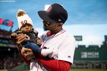 BOSTON, MA - APRIL 11: Mookie Betts #50 of the Boston Red Sox reacts with his daughter Kynlee as he is presented with his 2018 season awards before a game against the Toronto Blue Jays on April 11, 2019 at Fenway Park in Boston, Massachusetts. (Photo by Billie Weiss/Boston Red Sox/Getty Images) *** Local Caption *** Mookie Betts