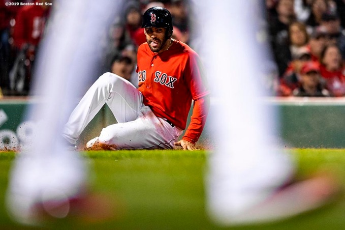 BOSTON, MA - APRIL 12: J.D. Martinez #28 of the Boston Red Sox slides as he scores during the eighth inning of a game against the Baltimore Orioles on April 12, 2019 at Fenway Park in Boston, Massachusetts. (Photo by Billie Weiss/Boston Red Sox/Getty Images) *** Local Caption *** J.D. Martinez