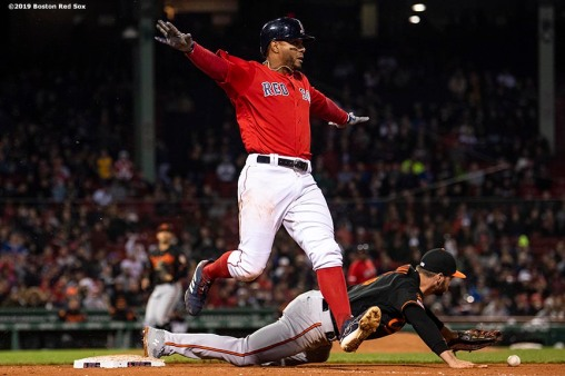 BOSTON, MA - APRIL 12: Xander Bogaerts #2 of the Boston Red Sox reacts as he beats out a throw dropped by Trey Mancini #16 of the Baltimore Orioles during the eighth inning of a game on April 12, 2019 at Fenway Park in Boston, Massachusetts. (Photo by Billie Weiss/Boston Red Sox/Getty Images) *** Local Caption *** Xander Bogaerts; Trey Mancini