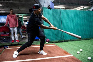 BOSTON, MA - APRIL 13: Singer Nicky Jam takes batting practice during a visit with the Boston Red Sox before a game against the Baltimore Orioles on April 13, 2019 at Fenway Park in Boston, Massachusetts. (Photo by Billie Weiss/Boston Red Sox/Getty Images) *** Local Caption *** Nicky Jam