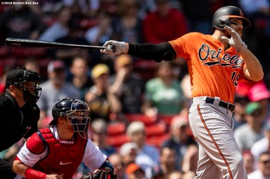 BOSTON, MA - APRIL 13: Chris Davis #19 of the Baltimore Orioles hits an RBI single during the first inning of a game against the Boston Red Sox on April 13, 2019 at Fenway Park in Boston, Massachusetts. (Photo by Billie Weiss/Boston Red Sox/Getty Images) *** Local Caption *** Chris Davis
