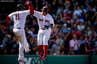 BOSTON, MA - APRIL 13: Christian Vazquez #7 of the Boston Red Sox reacts with Rafael Devers #11 after hitting a two run home run during the third inning of a game against the Baltimore Orioles on April 13, 2019 at Fenway Park in Boston, Massachusetts. (Photo by Billie Weiss/Boston Red Sox/Getty Images) *** Local Caption *** Christian Vazquez. Rafael Devers