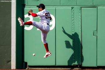 BOSTON, MA - APRIL 13: Mookie Betts #50 of the Boston Red Sox attempts to catch a fly ball during the eighth inning of a game against the Baltimore Orioles on April 13, 2019 at Fenway Park in Boston, Massachusetts. (Photo by Billie Weiss/Boston Red Sox/Getty Images) *** Local Caption *** Mookie Betts