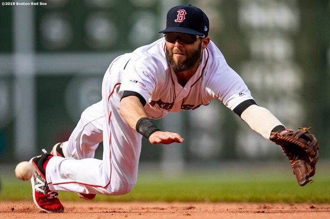 BOSTON, MA - APRIL 13: Dustin Pedroia #15 of the Boston Red Sox dives to field a ground ball during the eighth inning of a game against the Baltimore Orioles on April 13, 2019 at Fenway Park in Boston, Massachusetts. (Photo by Billie Weiss/Boston Red Sox/Getty Images) *** Local Caption *** Dustin Pedroia