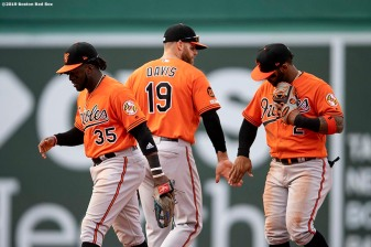 BOSTON, MA - APRIL 13: Chris Davis #19 of the Baltimore Orioles high fives teammates after a game against the Boston Red Sox on April 13, 2019 at Fenway Park in Boston, Massachusetts. (Photo by Billie Weiss/Boston Red Sox/Getty Images) *** Local Caption *** Chris Davis
