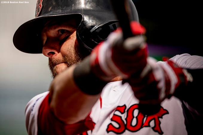 BOSTON, MA - APRIL 14: Dustin Pedroia #15 of the Boston Red Sox warms up during the first inning of a game against the Baltimore Orioles on April 14, 2019 at Fenway Park in Boston, Massachusetts. (Photo by Billie Weiss/Boston Red Sox/Getty Images) *** Local Caption *** Dustin Pedroia